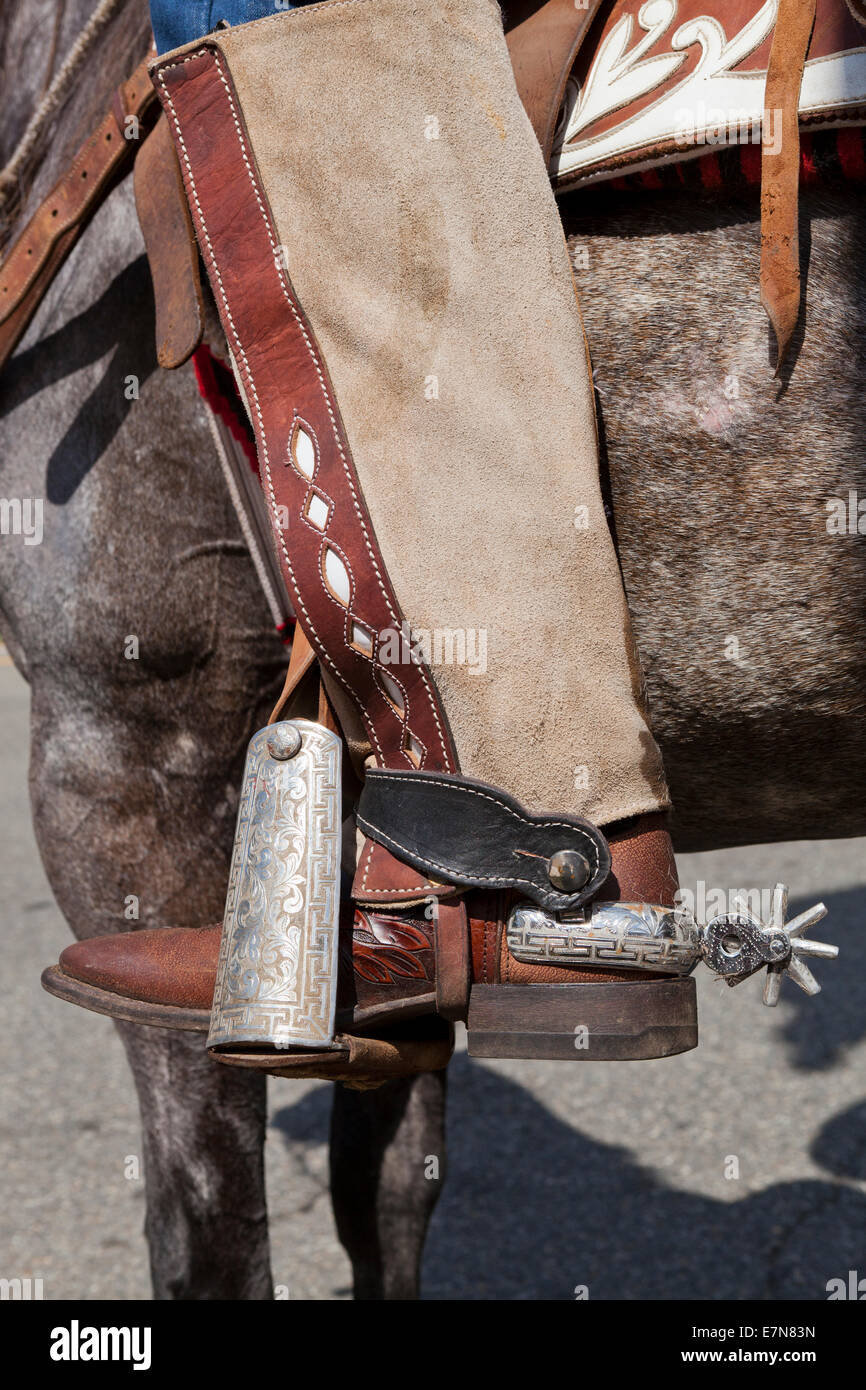closeup of Western-style cowboy spur on riding boots - USA - Stock Image