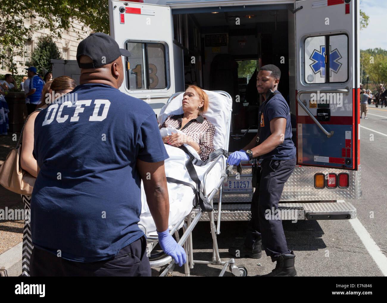 DCFD EMT loading patient into ambulance - Washington, DC USA Stock Photo