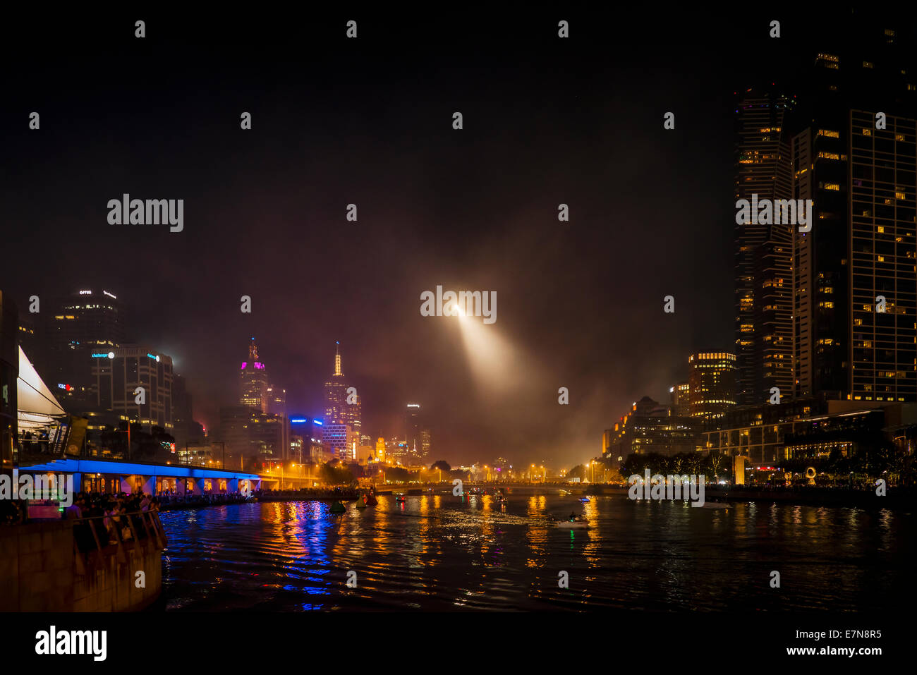 A helicopter search light at night view over the Yarra River in downtown Melbourne, Australia. - Stock Image