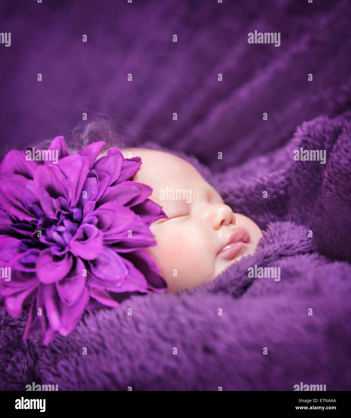 Closeup Portrait Of Cute Sleepy Baby Girl With Stylish Purple Flower Stock Photo Alamy