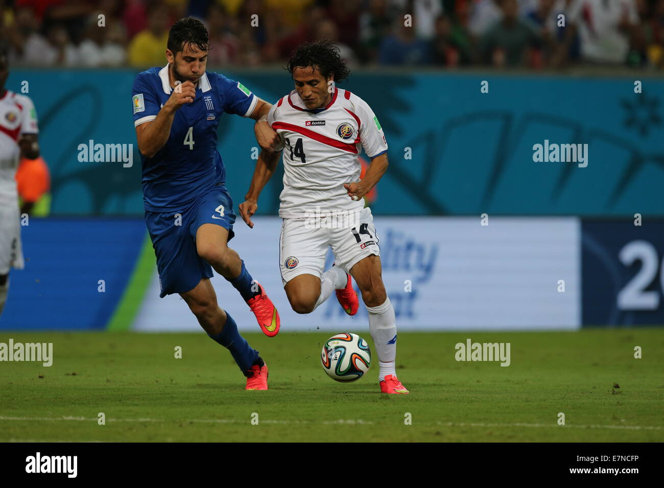 Konstantinos Manolas of Greece and Randall Brenes of Costa Rica. Greece v Costa Rica FIFA World Cup Brazil 2014. - Stock Image