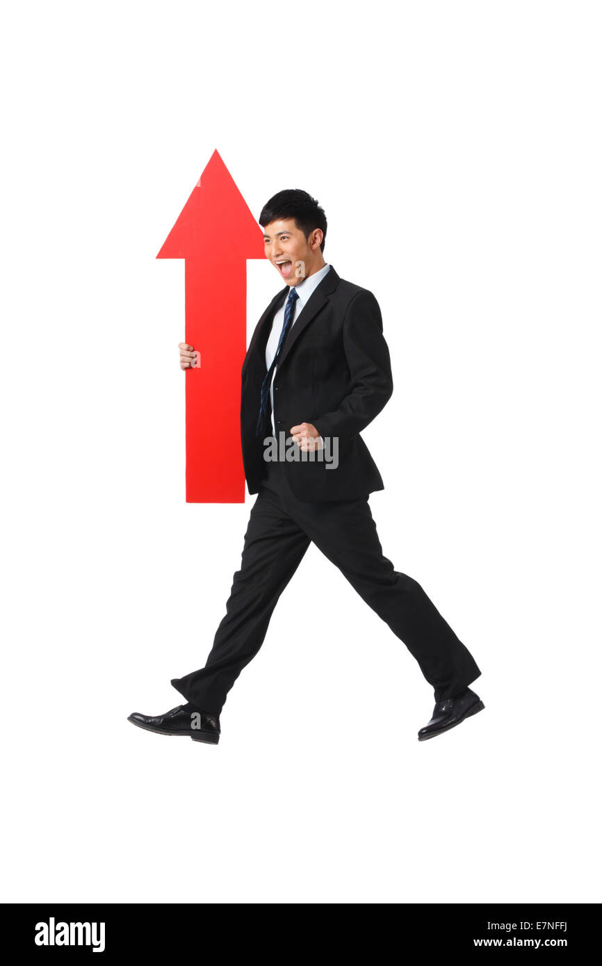 Business man holding a red arrow Stock Photo