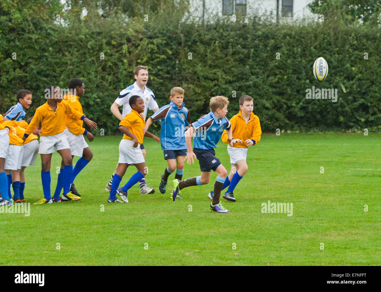 school children playing rugby in the United Kingdom - Stock Image