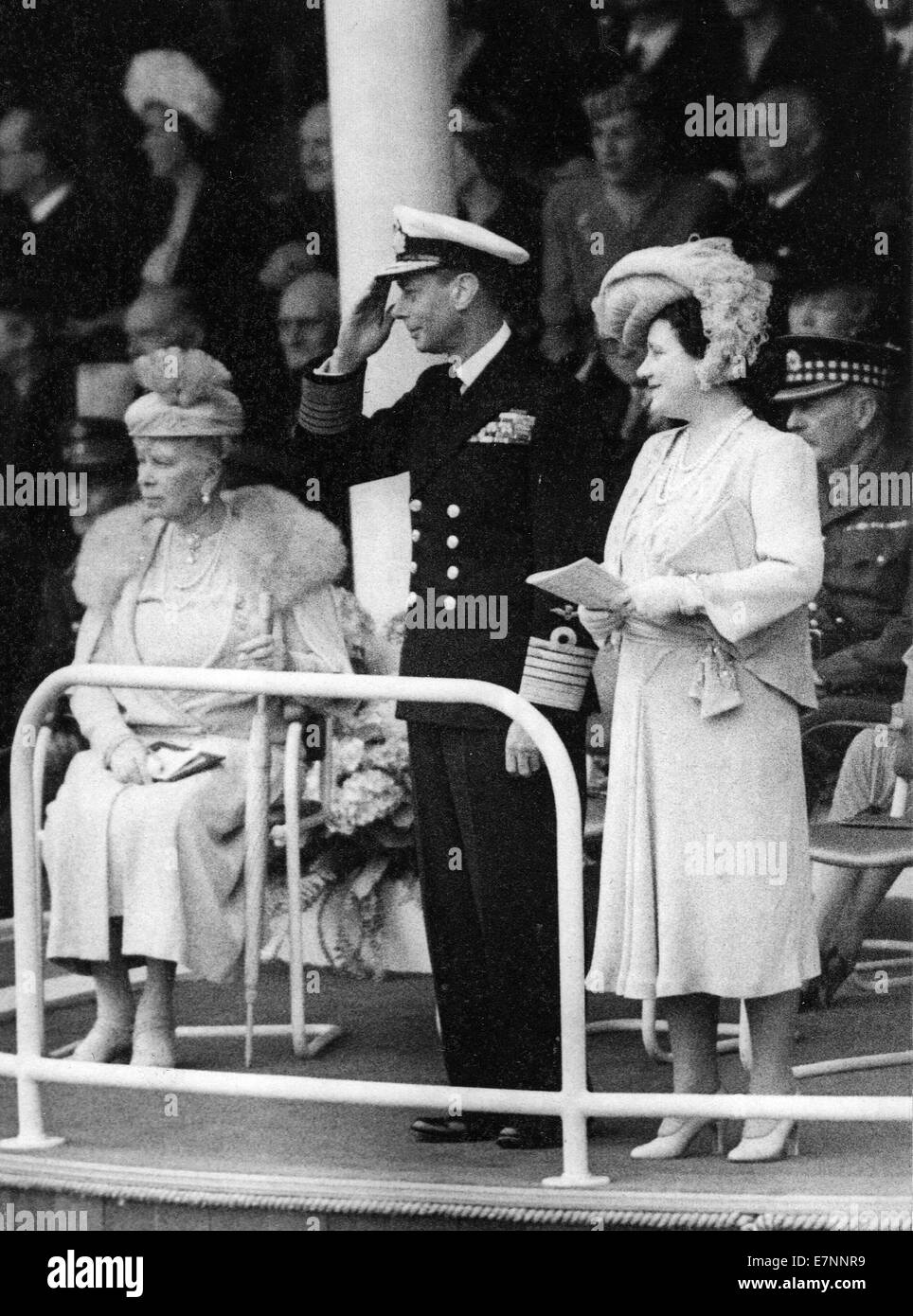 Queen Mary, King George, Queen Elizabeth take the salute at the victory parade at the end of WW11 - Stock Image