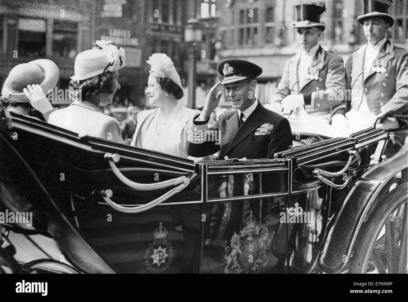 King George, Queen Elizabeth, Princess Margaret and Princess Elizabeth in the state landau at the end of WW11 - Stock Image
