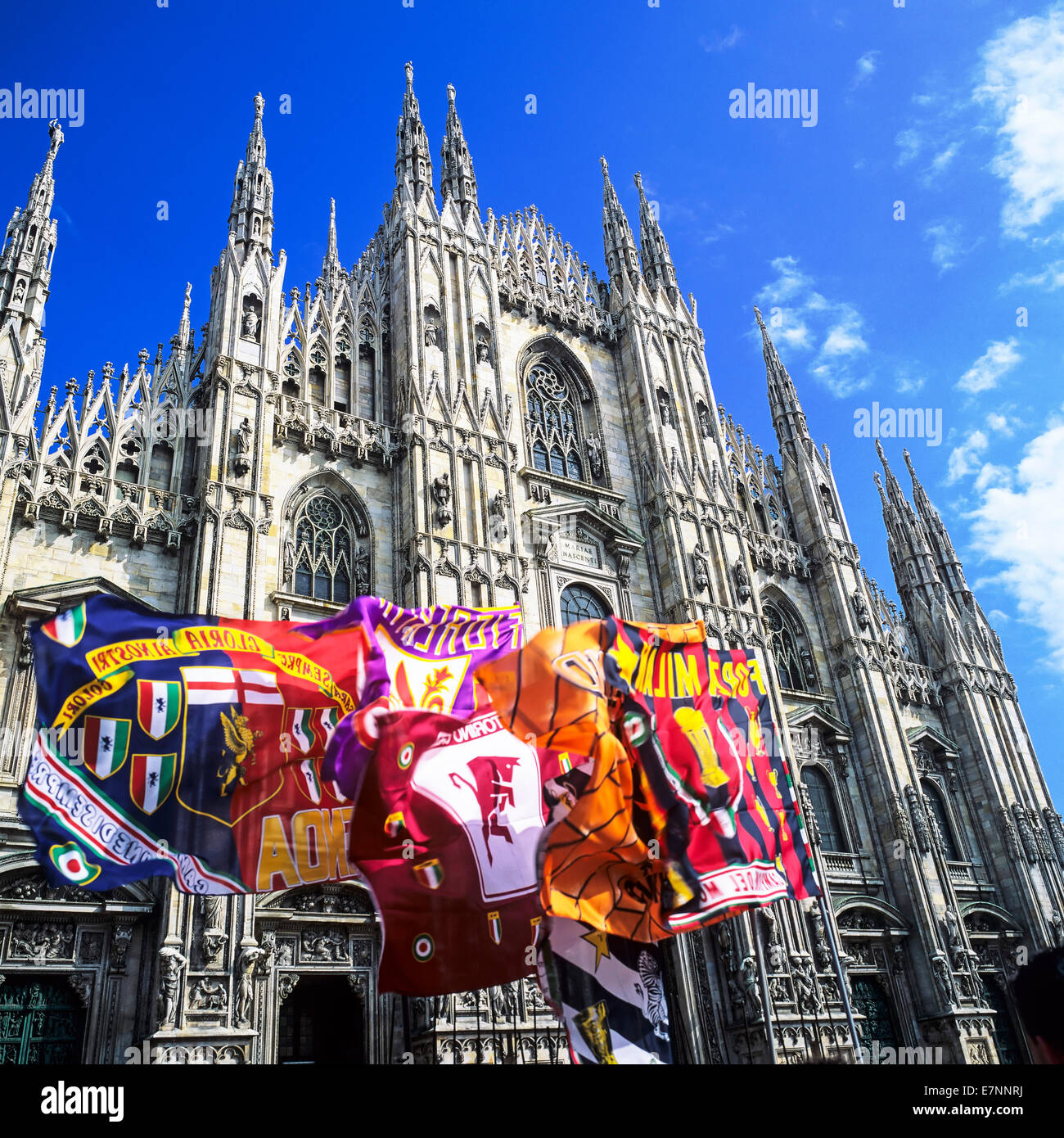 Flags and Duomo cathedral Milan Lombardy Italy - Stock Image