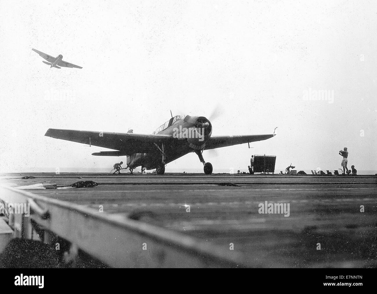 Royal Navy Grumman Avenger aircraft lands on the flight deck of a carrier during WW11 - Stock Image