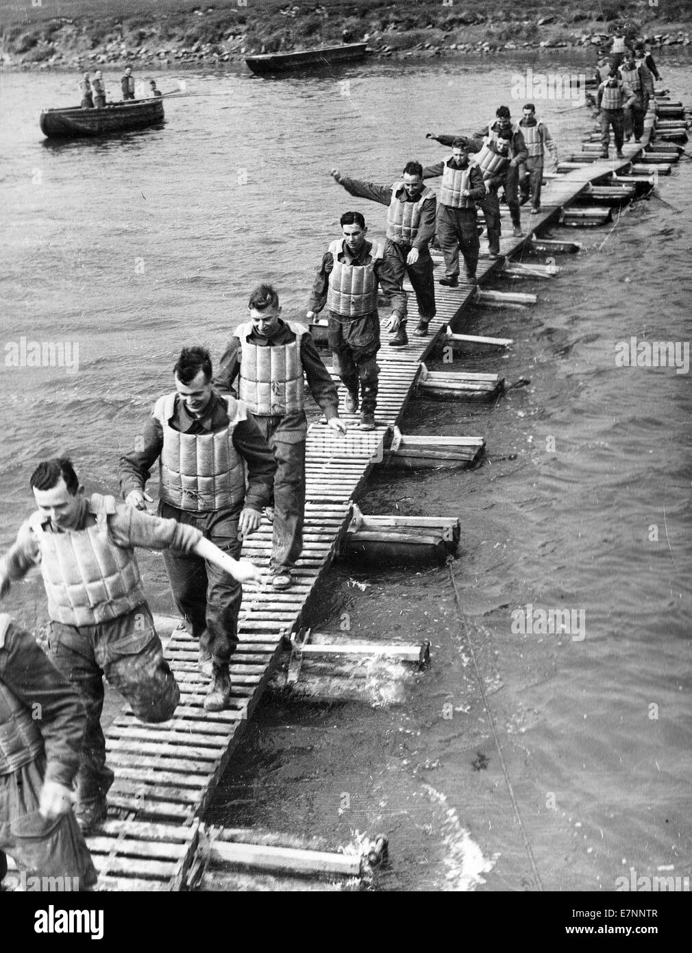 British Royal Engineers test a newly built infantry bridge across a river. WW2 - Stock Image