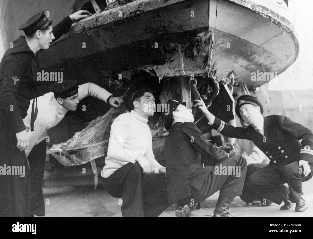 Royal Navy crew inspect a damaged MTB - Stock Image