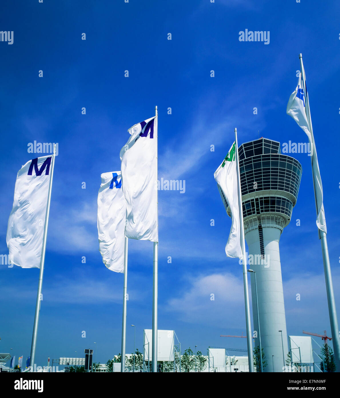Flags and control tower at Franz-Joseph Strauss airport Munich Bavaria Germany Europe - Stock Image
