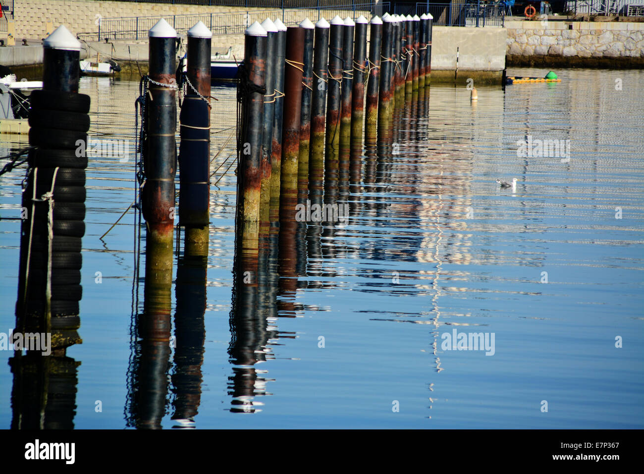 Berthing poles at Queensway Quay Marina in Gibraltar for the town house and apartments. Marina berths and moorings. - Stock Image