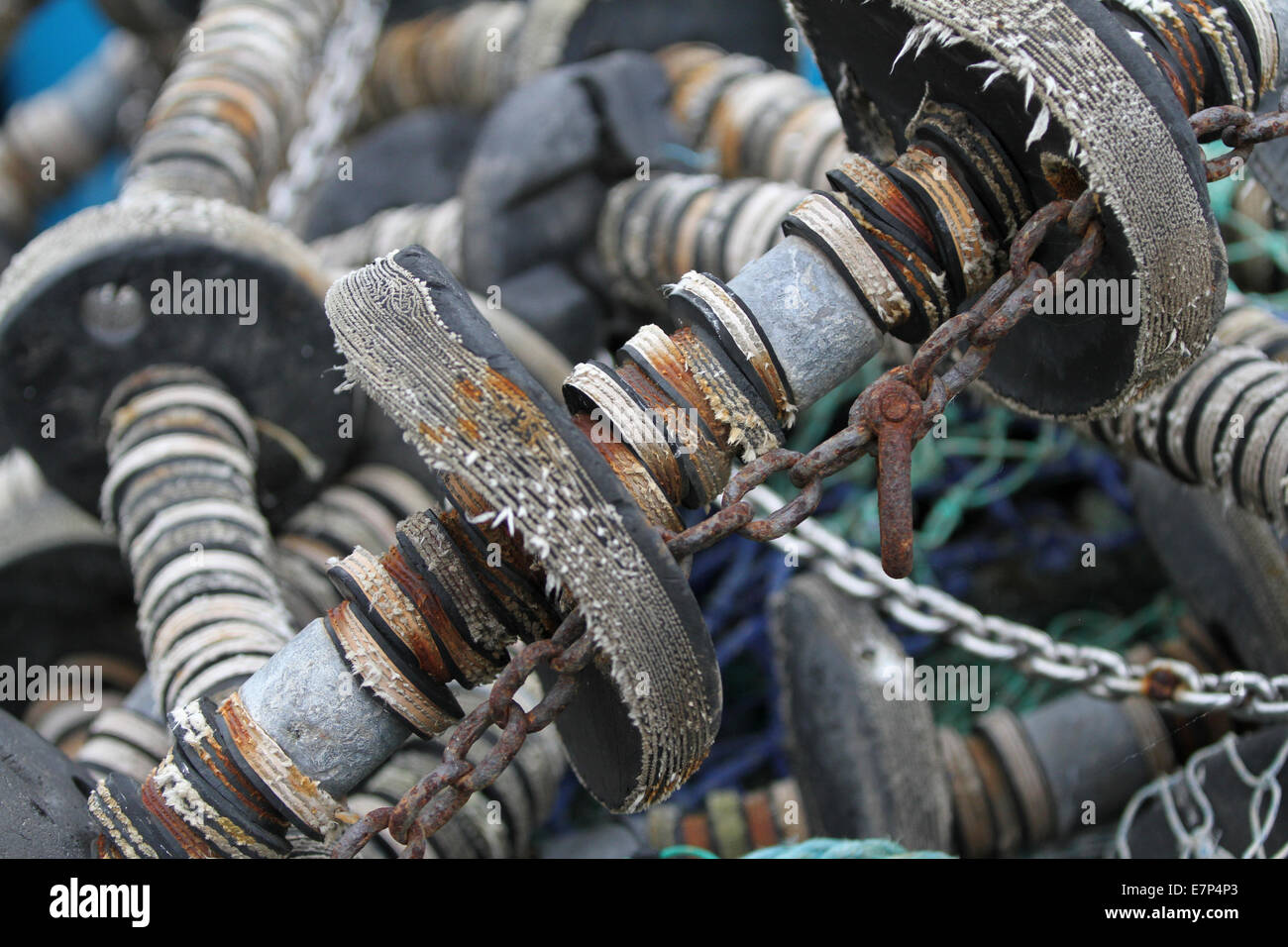 Commercial trawler fishing nets, ropes, chains, bobbins and spacers, drying on the quayside at Scarborough, North - Stock Image