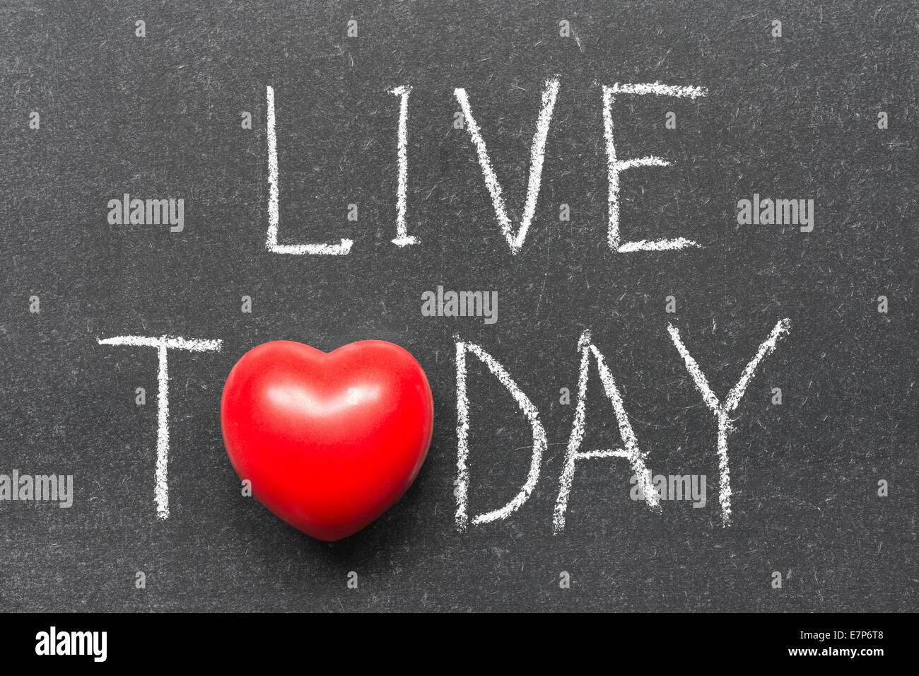 live today phrase handwritten on chalkboard with heart symbol instead of O - Stock Image
