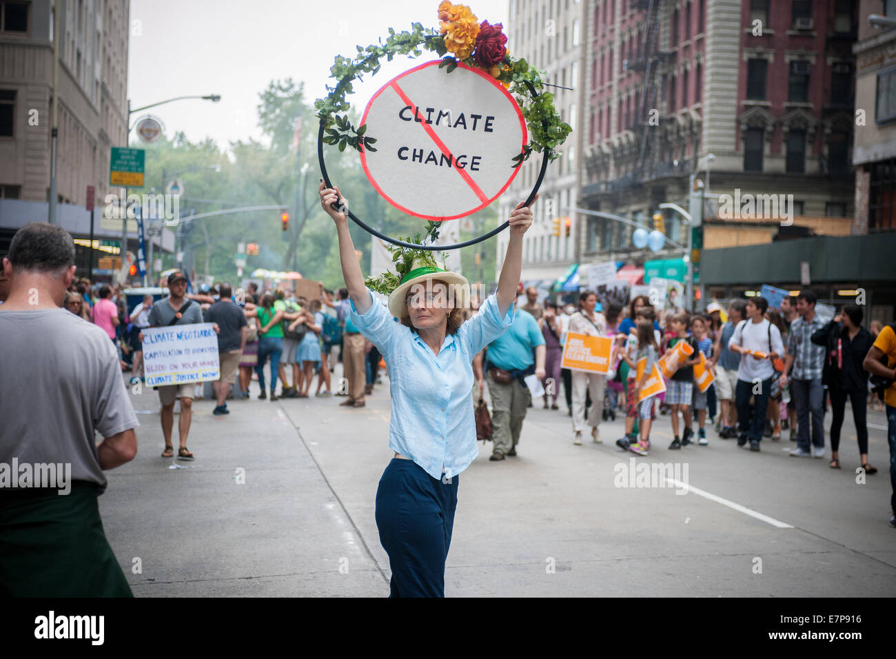 A woman holds a sign against climate change in Midtown Manhattan in New York in the People's Climate march - Stock Image