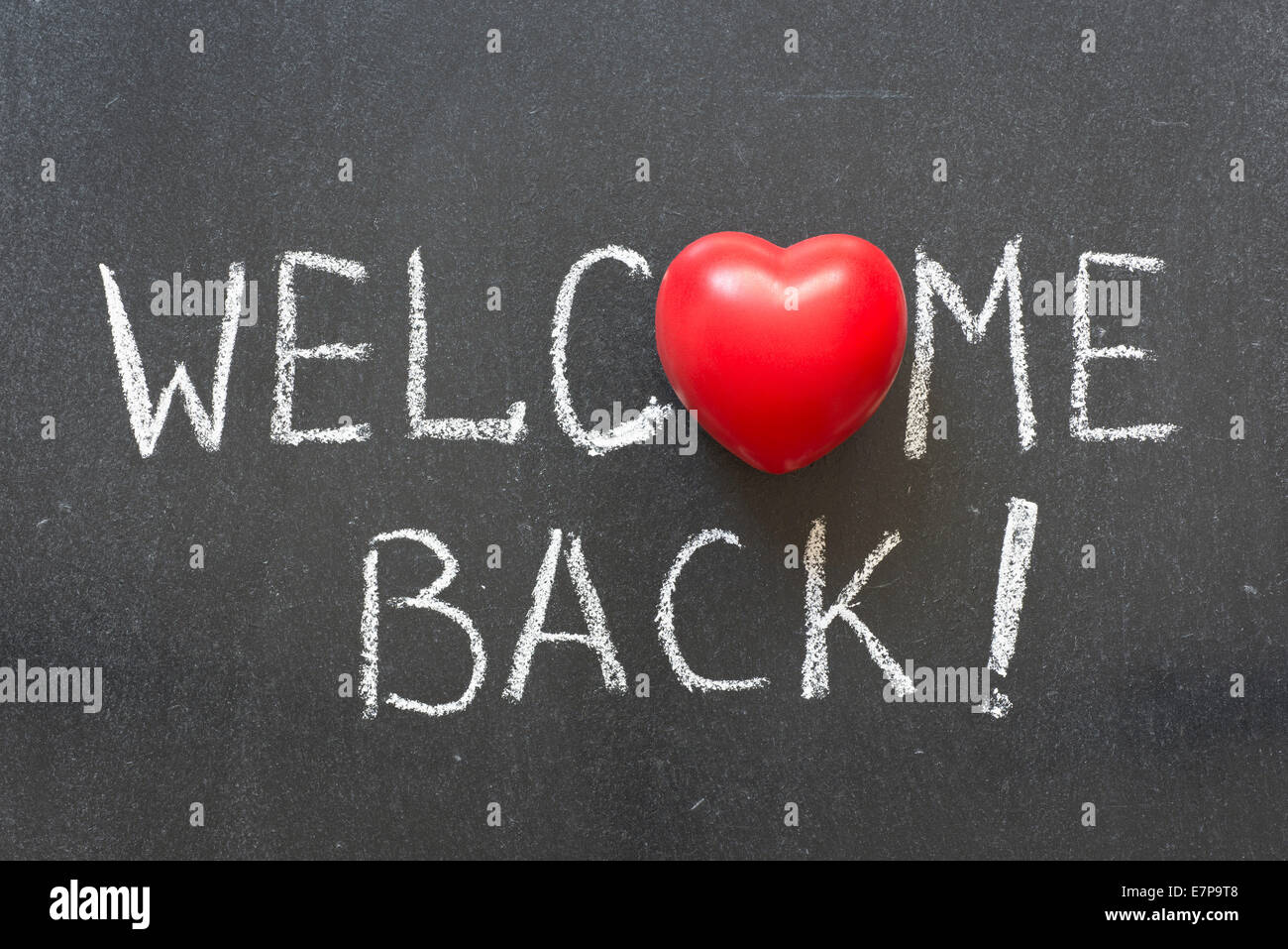 Welcome Back Phrase Handwritten On Chalkboard With Heart Symbol