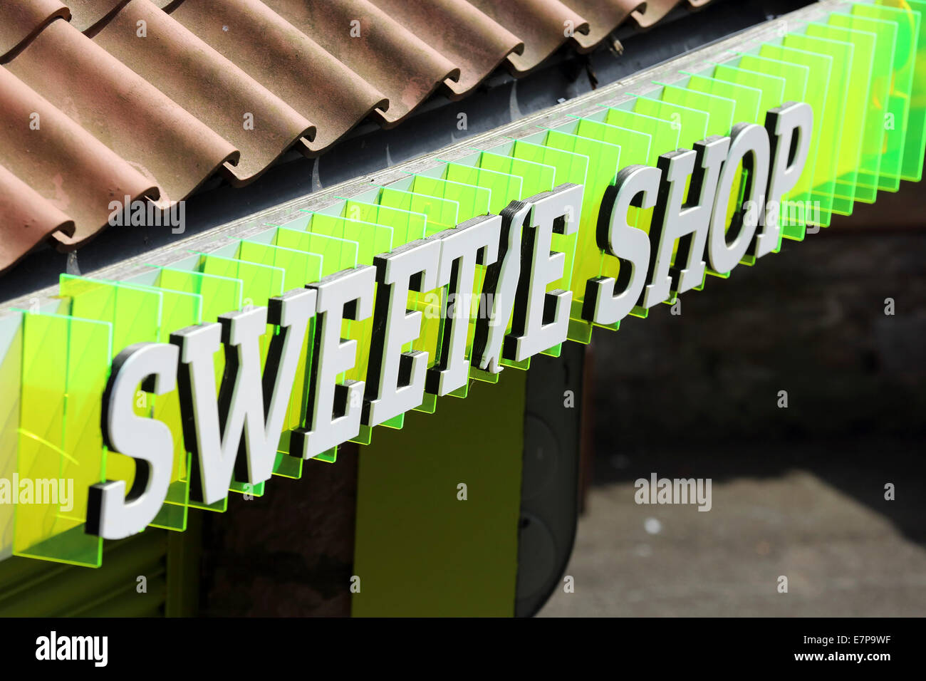 Sign for a sweetie shop in Edinburgh, Scotland. The shop sells candies and sweets. - Stock Image