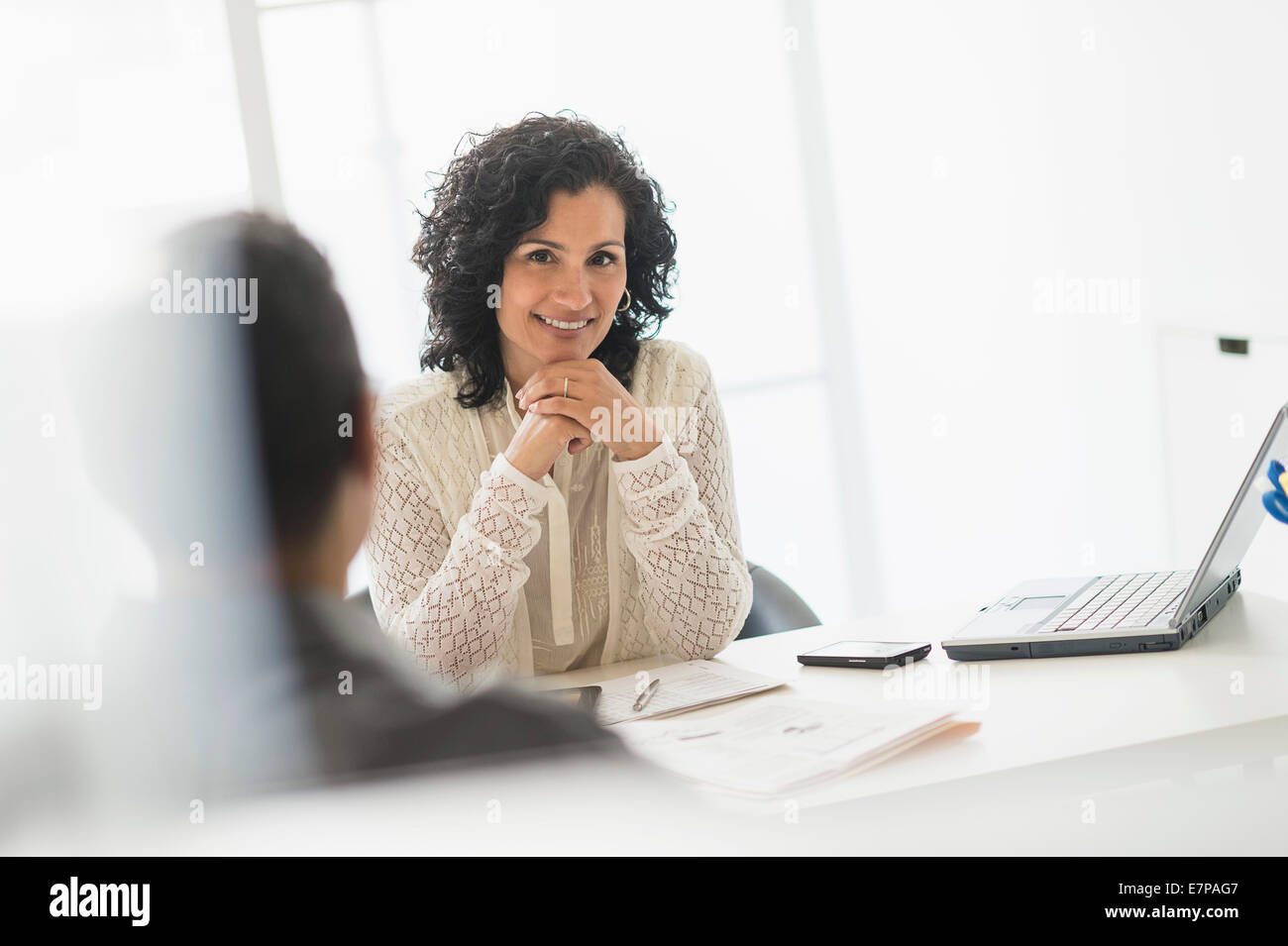 Portrait of businesswoman in office - Stock Image