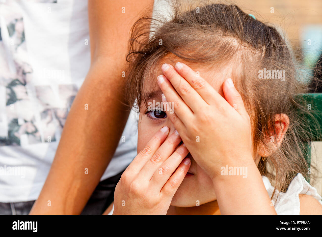 Shy Child, Hartfield Village Fete, Sussex, England - Stock Image