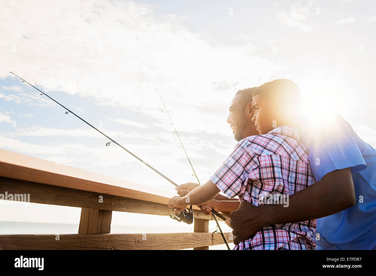 Father and son (10-11) fishing - Stock Image