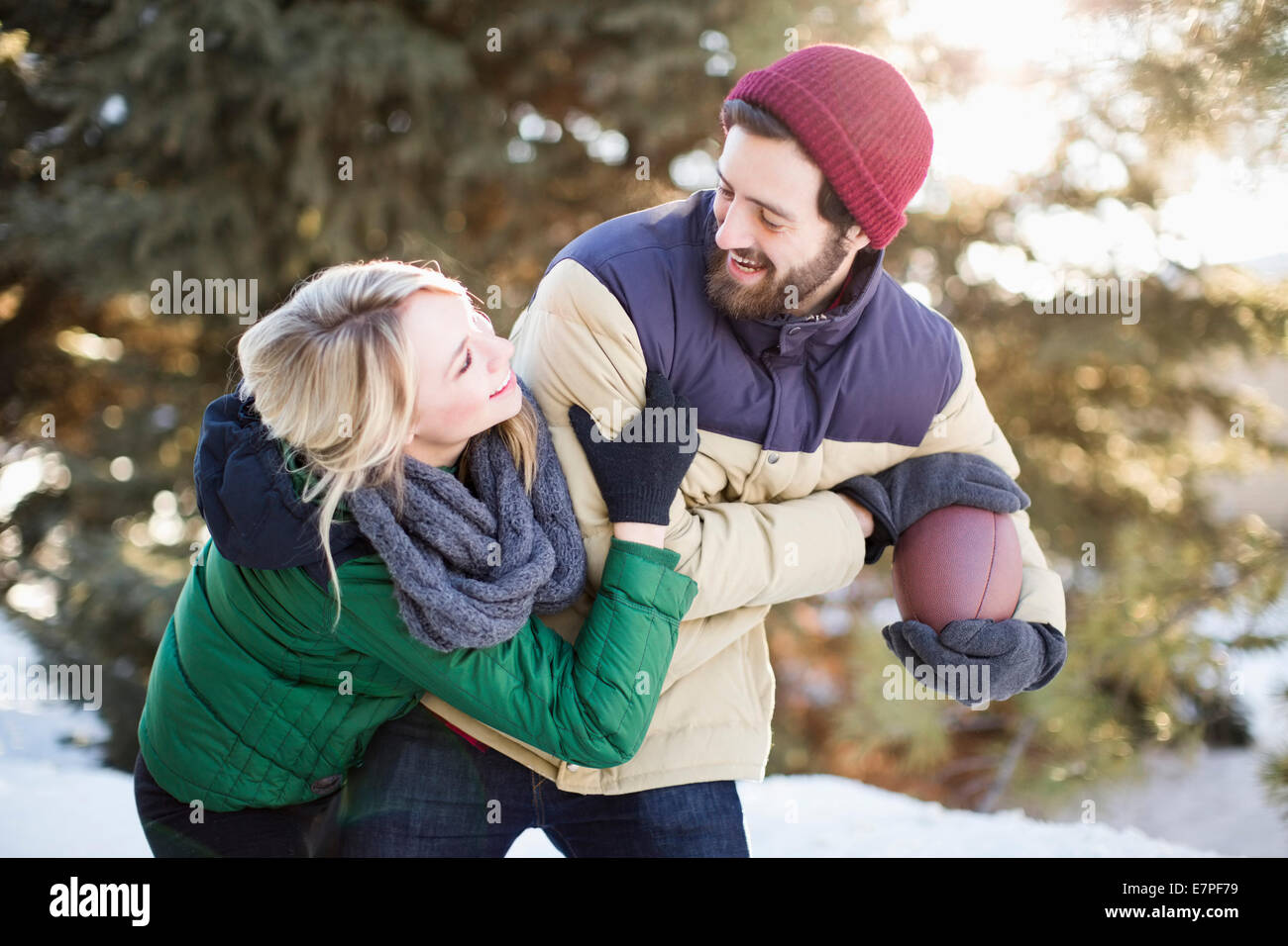 USA, Utah, Salt Lake City, Couple playing American football - Stock Image