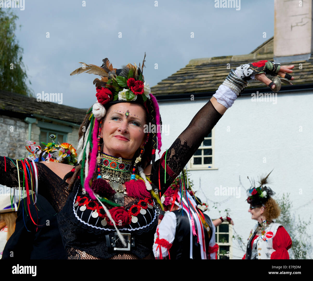 Member of the 400 Roses dance troupe performing at Otley Folk Festival, September 2014 - Stock Image