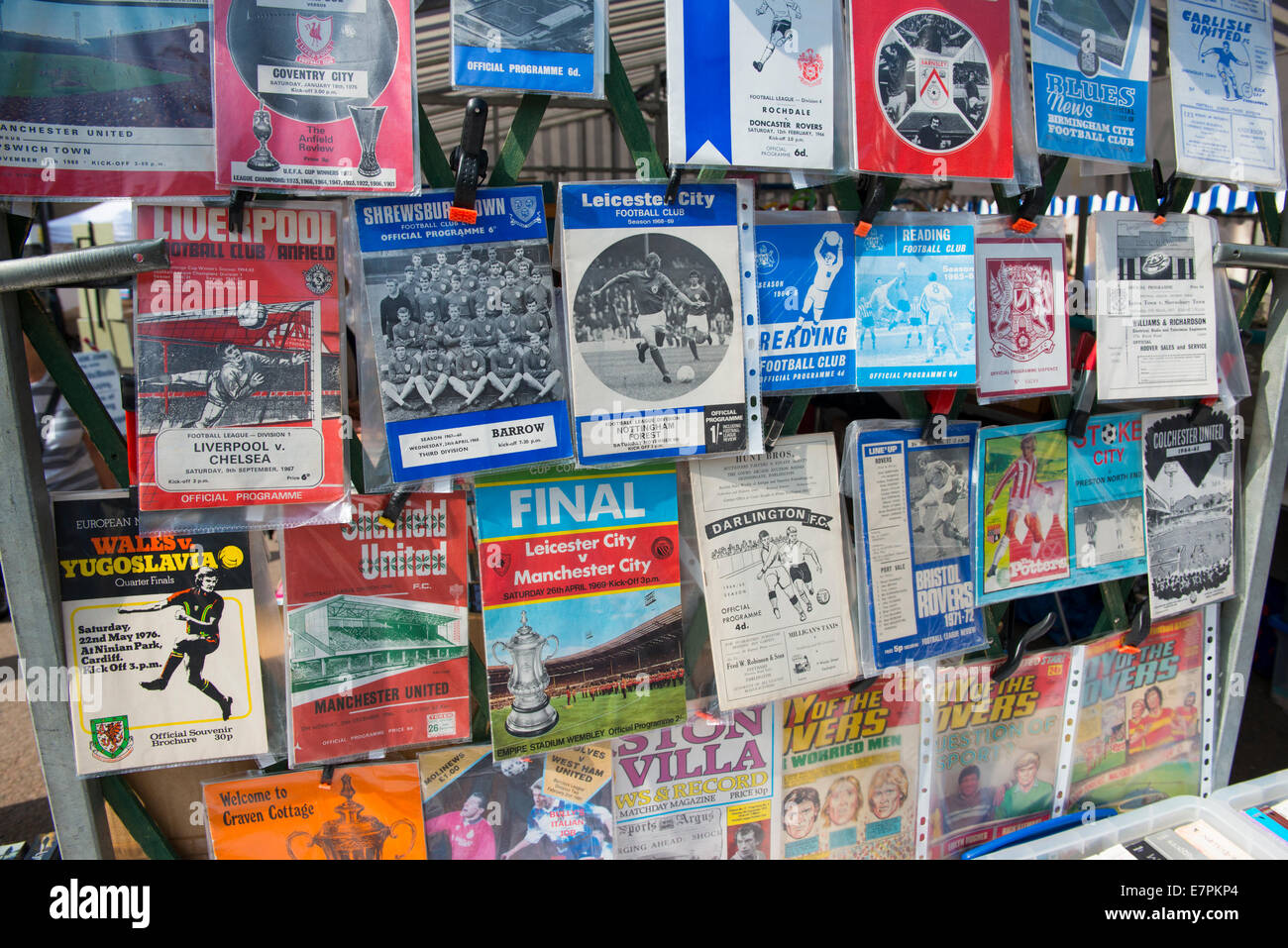 Old football programmes on sale at a Ludlow street market, Shropshire, England - Stock Image