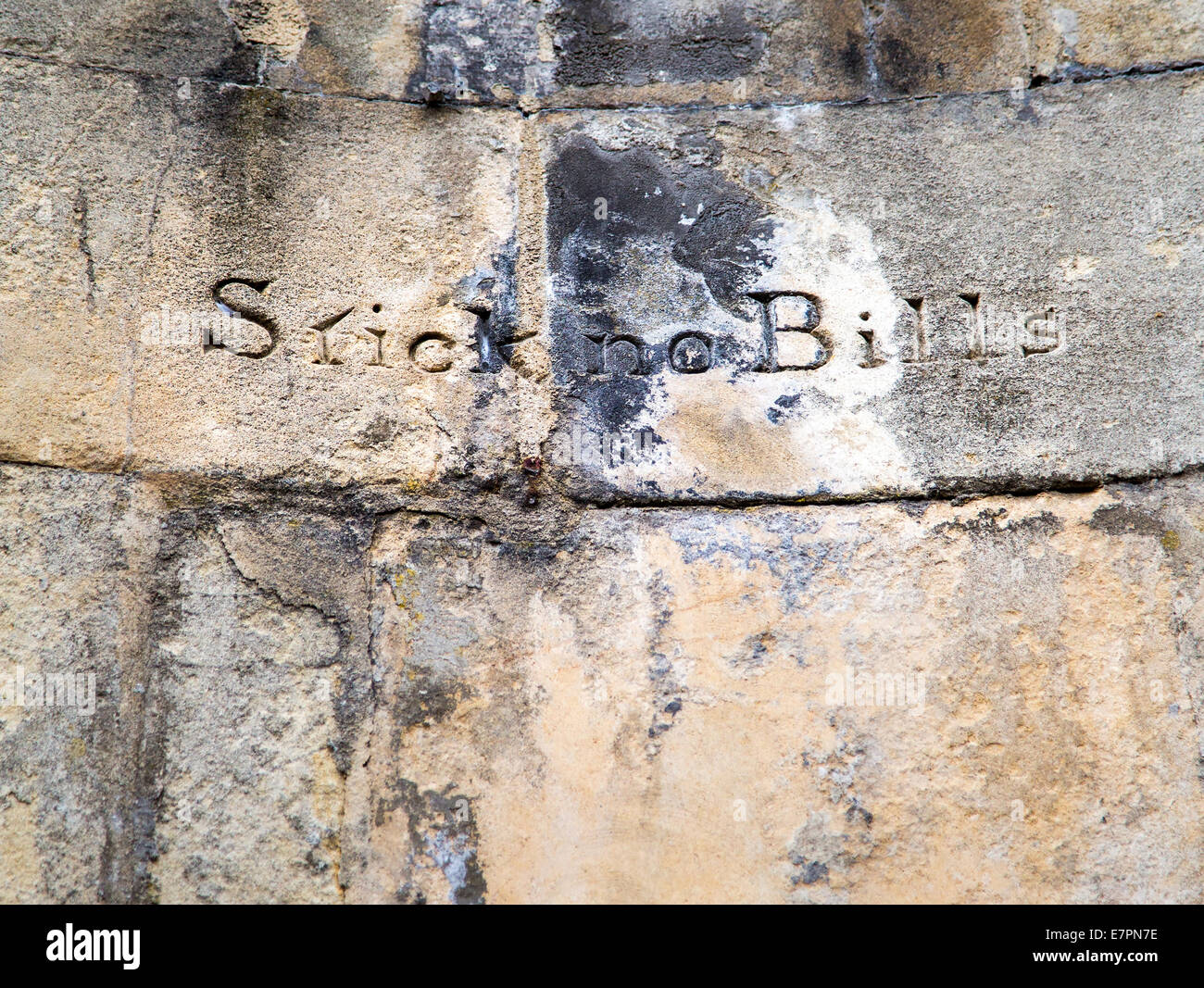 Stick no Bills sign carved into a section of wall on Royal York Crescent in Clifton Bristol - Stock Image