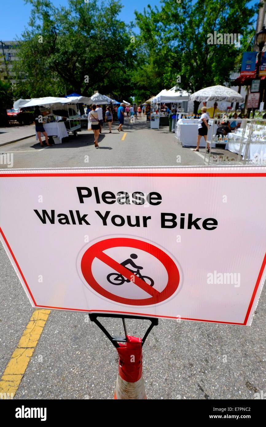Sign Please Walk Your Bike Bradenton FL Florida US - Stock Image