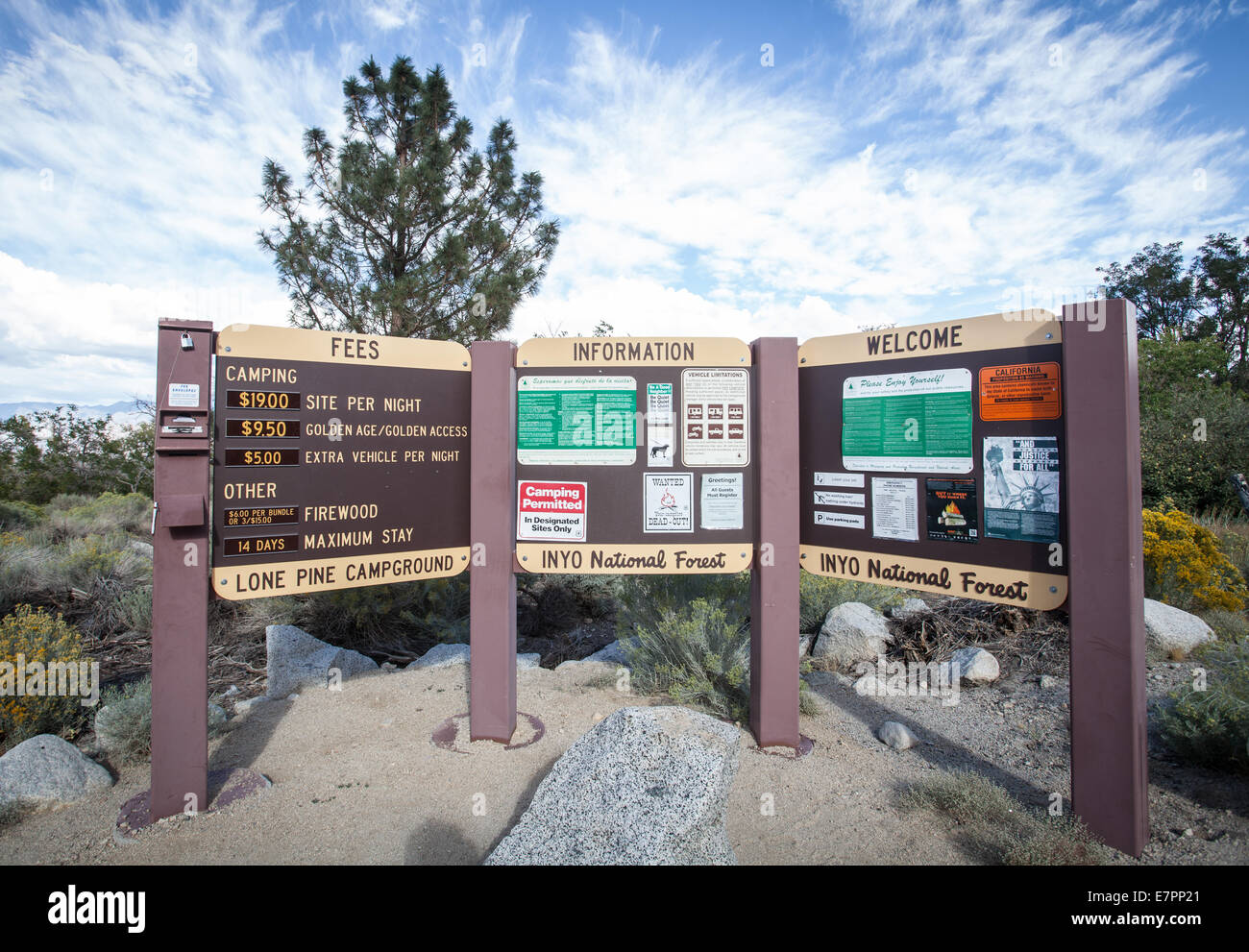 Fees and Information boards at a campground in the Inyo National Forest. - Stock Image