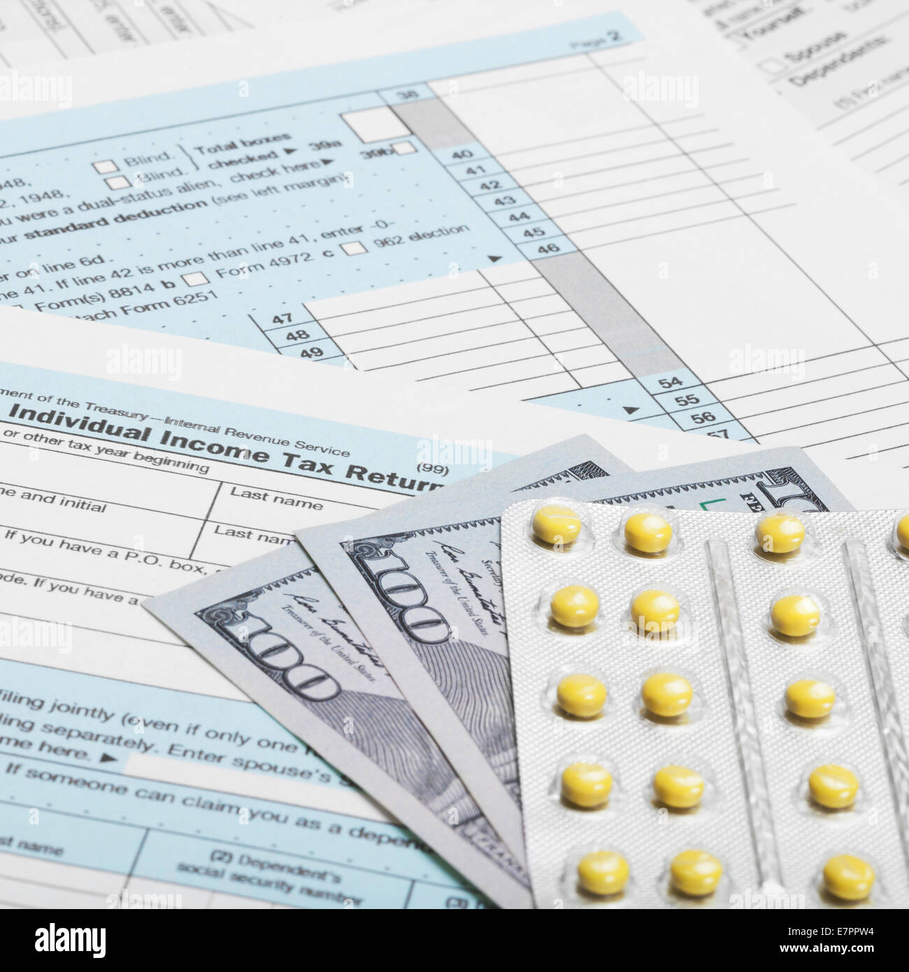 Us Tax Form 1040 With 100 Dollars And Pills 1 To 1 Ratio Stock