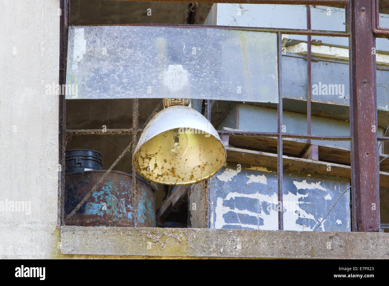 Streetlight against a decrepit building (Peters Cartridge Factory near Mils, Ohio) - Stock Image