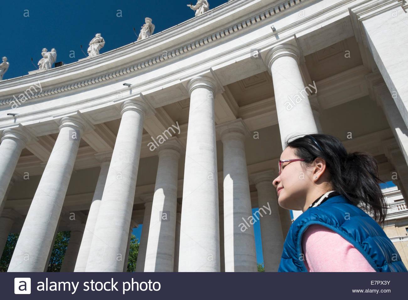 Asian Female Tourist at Piazza San Pietro in Citta del Vaticano, Rome, Italy - Stock Image