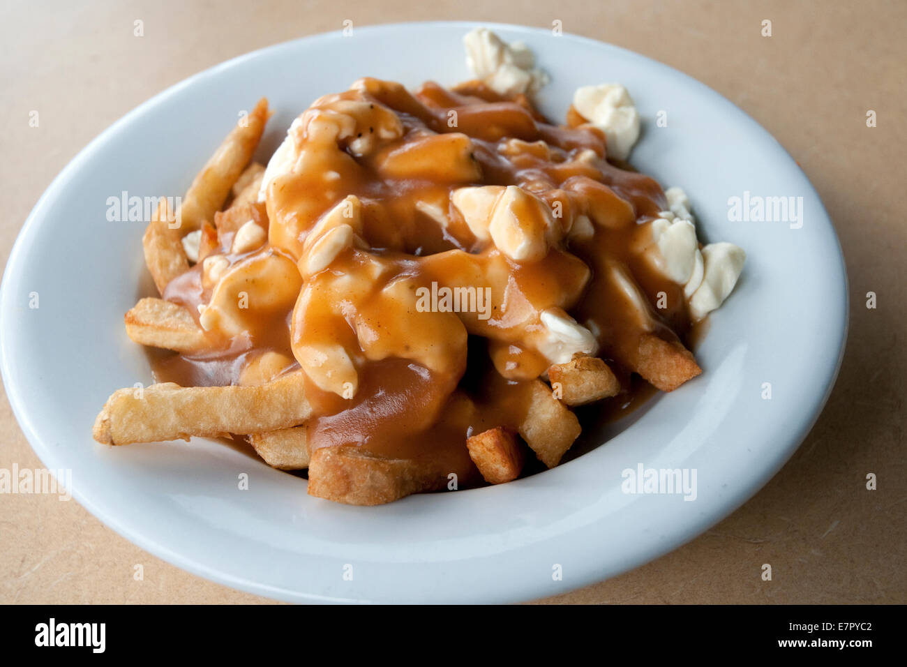 The famous 'traditional' poutine at Le Roy Jucep restaurant (the inventors of the dish) in Drummondville, - Stock Image