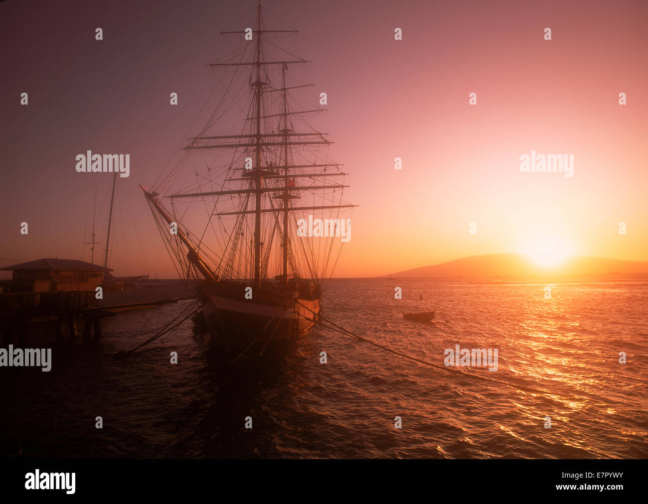 Schooner anchored in Lahaina on Island of Maui at sunset - Stock Image