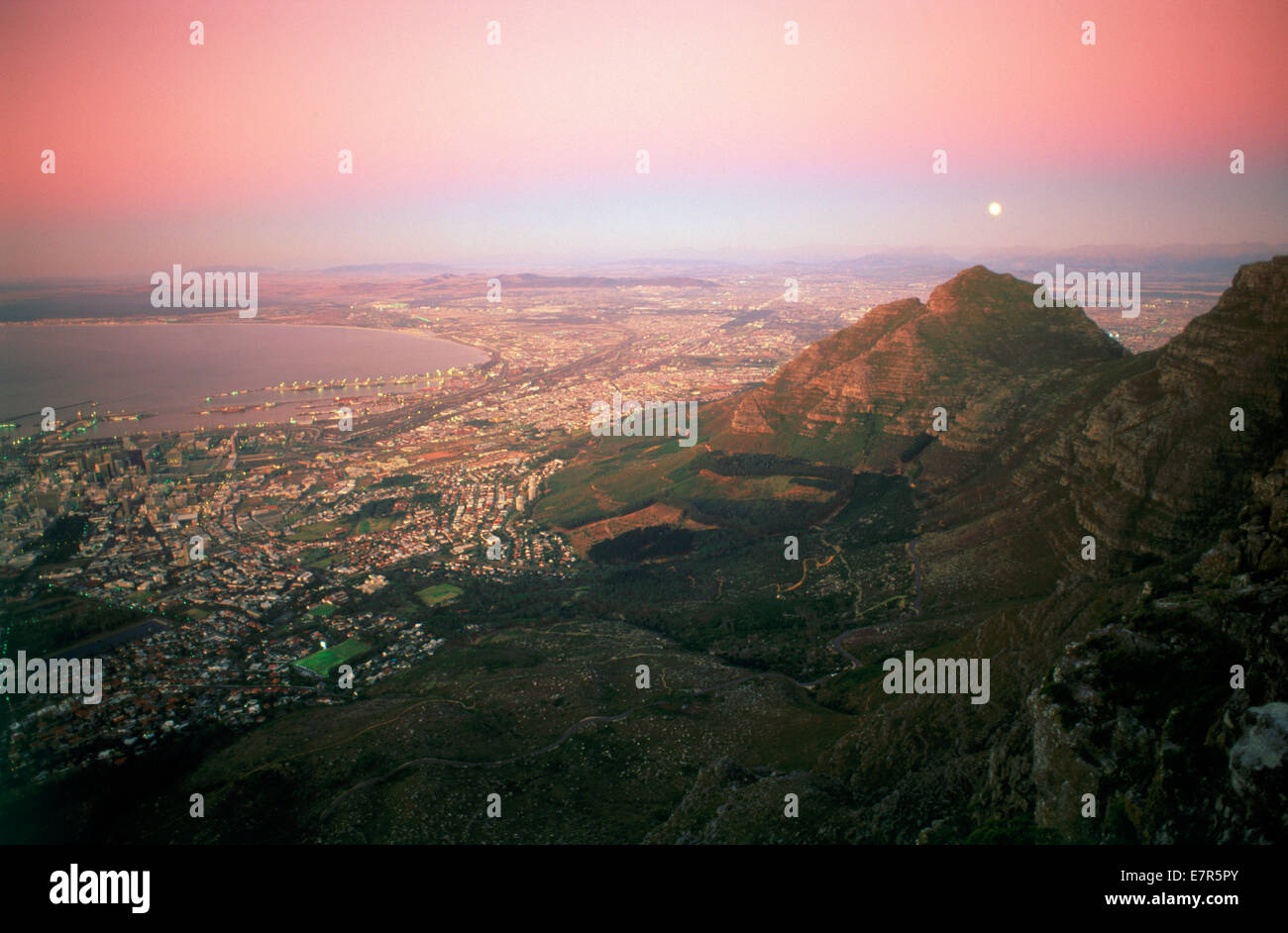 Moon over Cape Town and Table Bay at twilight from Table Mountain - Stock Image