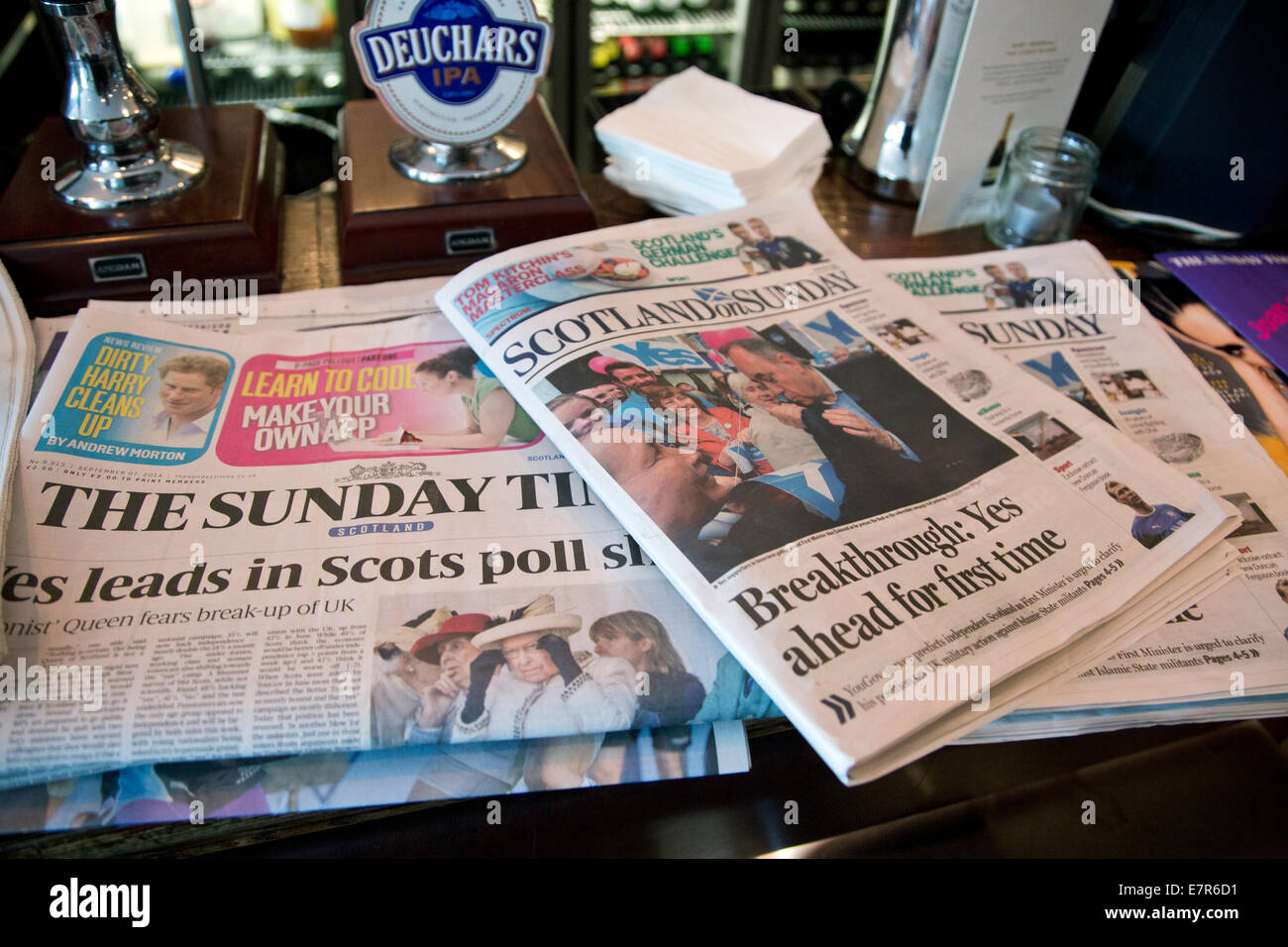 A selection of Sunday newspapers lying on a bar in Edinburgh describing the latest political situation regarding - Stock Image