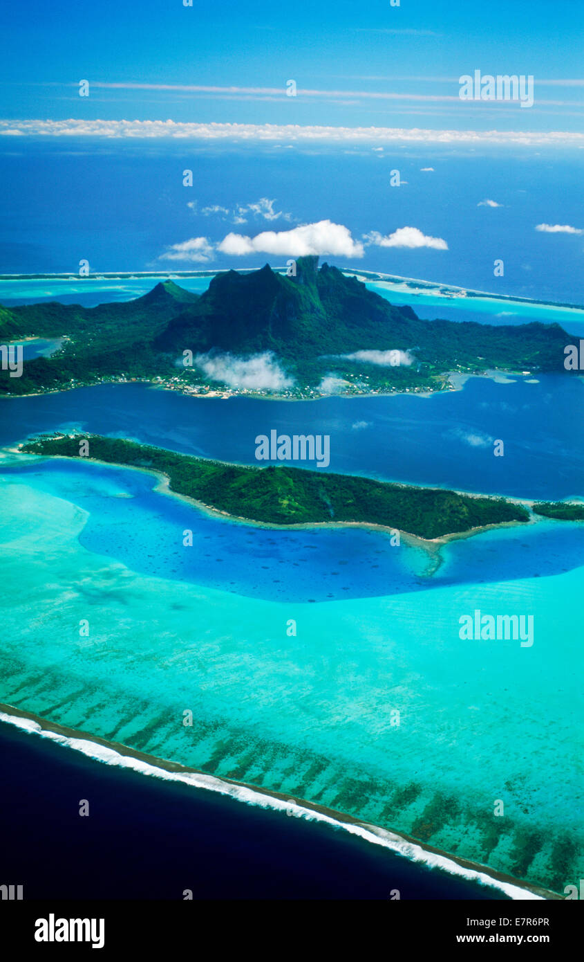 Aerial view of Bora Bora Island anchored in blue South Pacific in the French Polynesia archipelago also called Society - Stock Image
