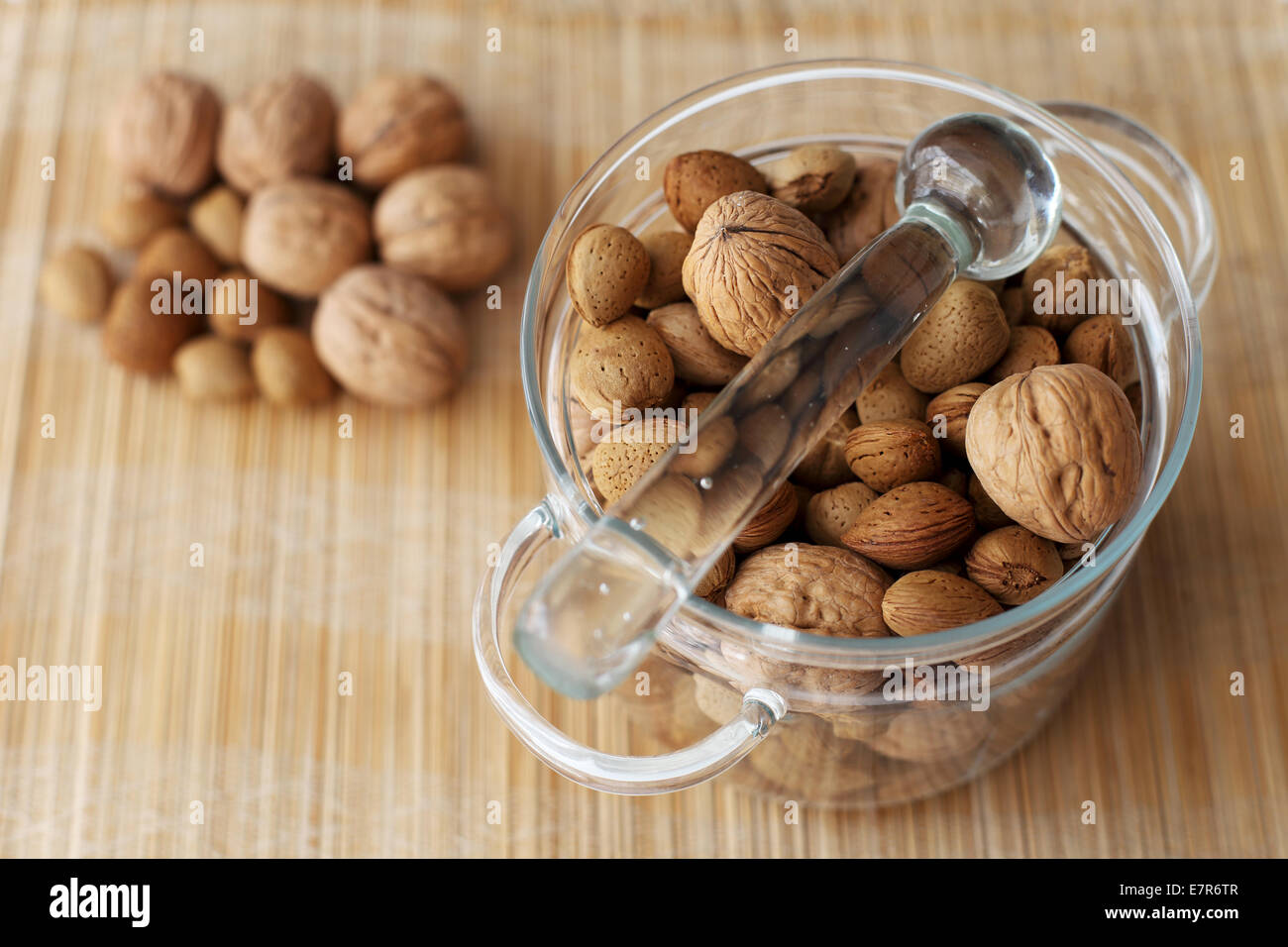Apricot Kernel and Walnut in a Glass Bowl - Stock Image