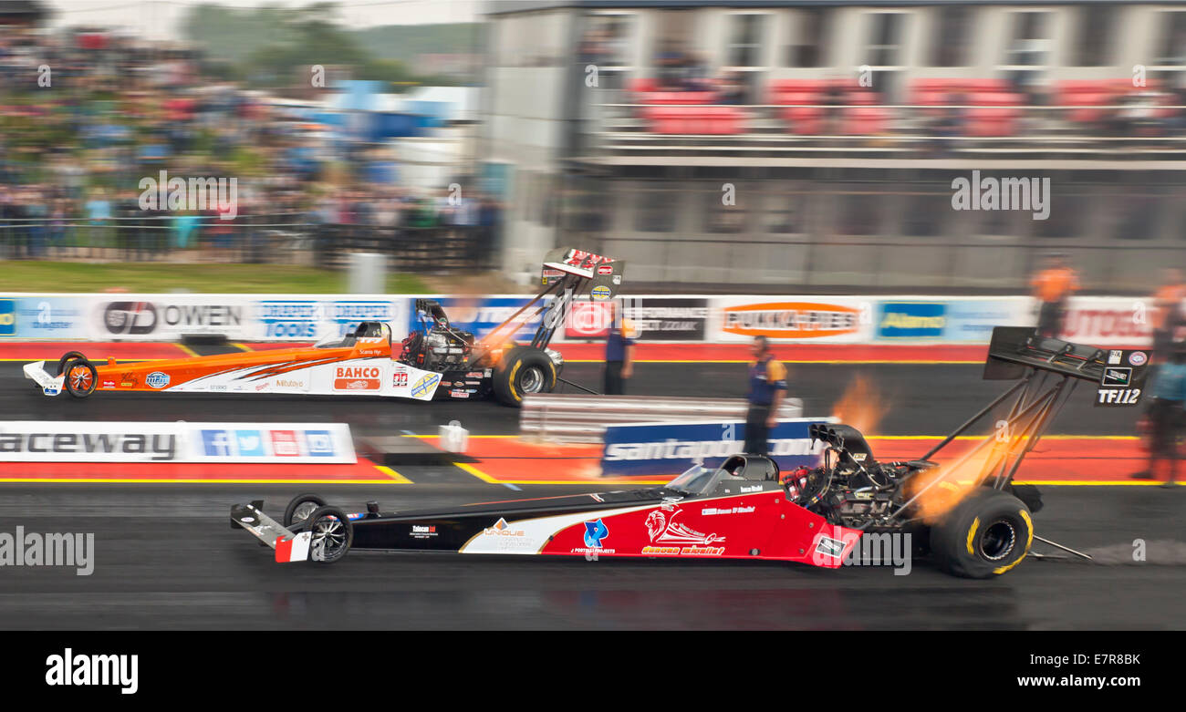 Top fuel drag racing at Santa Pod. Duncan Micallef nearside, Mikael Kagered far side. - Stock Image