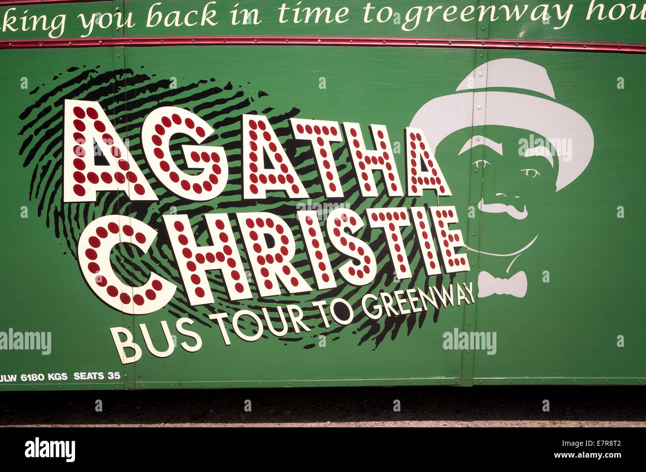 AGATHA CHRISTIE on side of old bus used to convey tourists to Greenway House in Devon - Stock Image