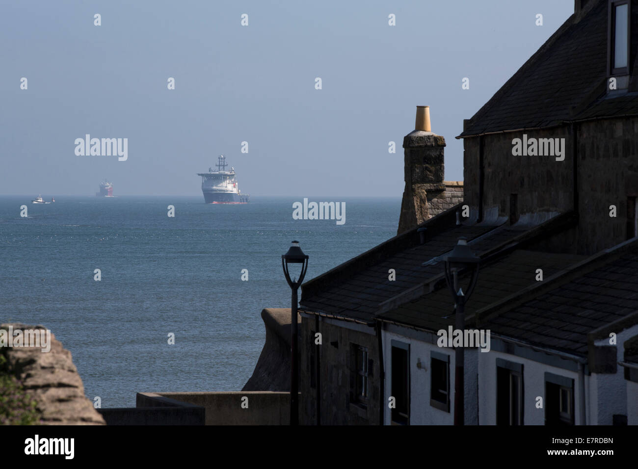 A supply ship sailing towards the historic Footdee area of Aberdeen, Scotland. - Stock Image