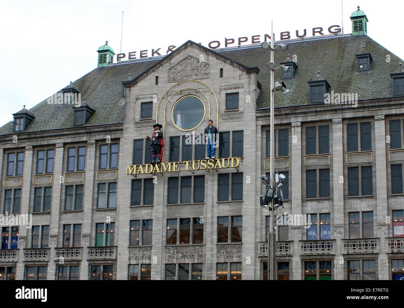 Exterior and facade of Madame Tussauds wax sculpture museum at Dam Square in Amsterdam The Netherlands - Stock Image