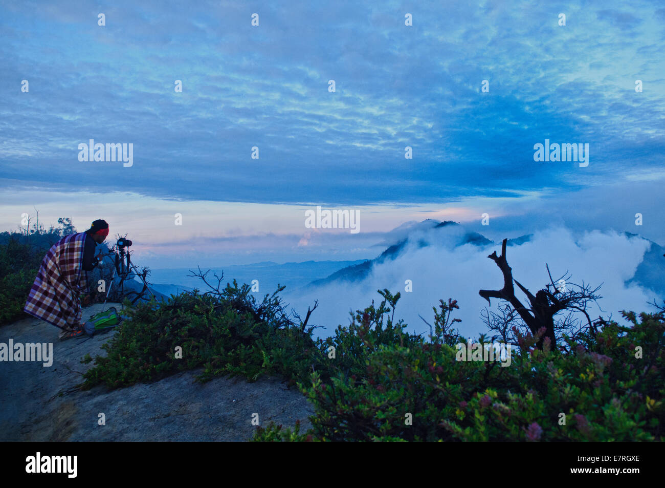 A photographer on top of the Mount Kawah Ijen in East Java, Indonesia - Stock Image