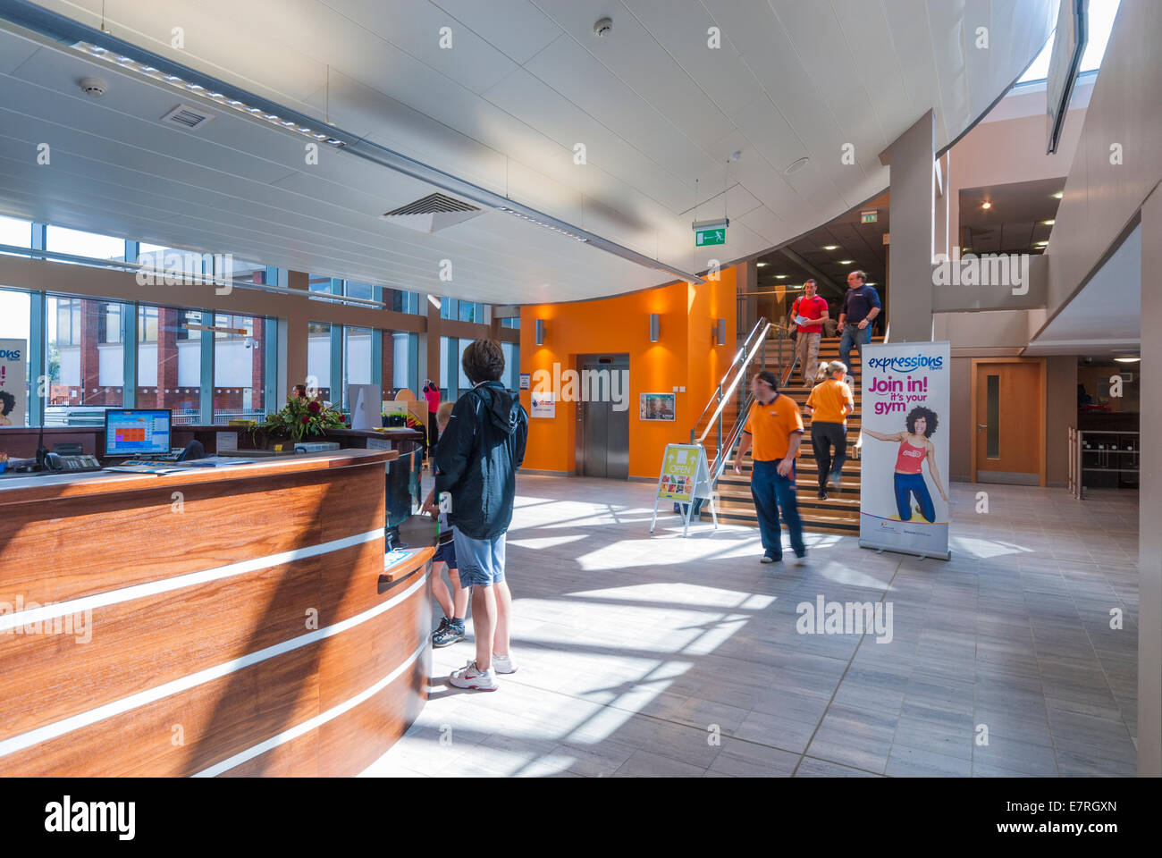 People entering a modern leisure centre reception area Mountbatten swimming pool portsmouth