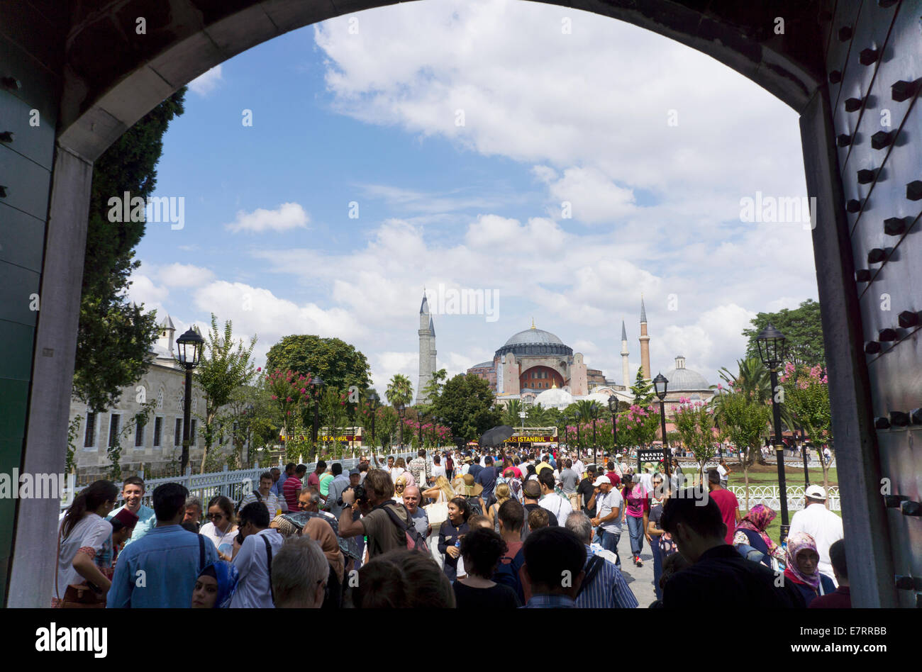 Istanbul, Turkey - August 3, 2014: Visitors near the Blue Mosque in Istanbul. The city receives over 10 million - Stock Image