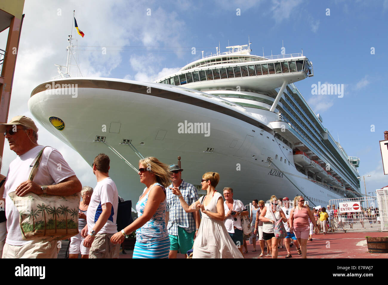 Passengers leaving the Cruise ship the AZURA - Stock Image