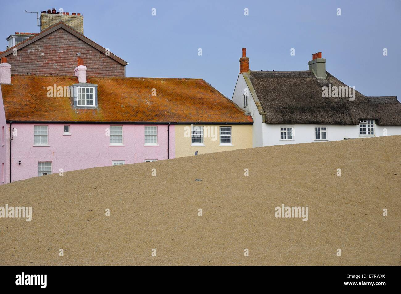 Houses fronting the shingle beach at West Bay, Bridport in Dorset - Stock Image