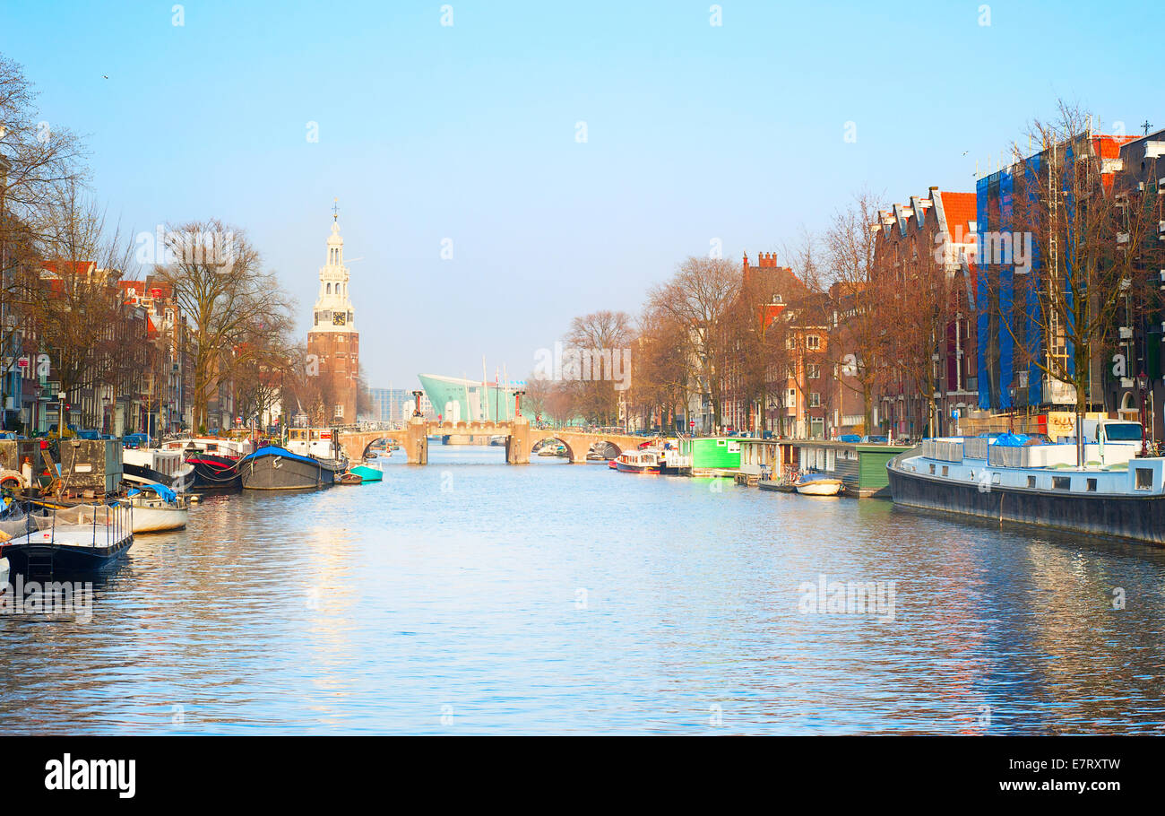 View of a Amsterdam canal at sunset. Netherlands - Stock Image