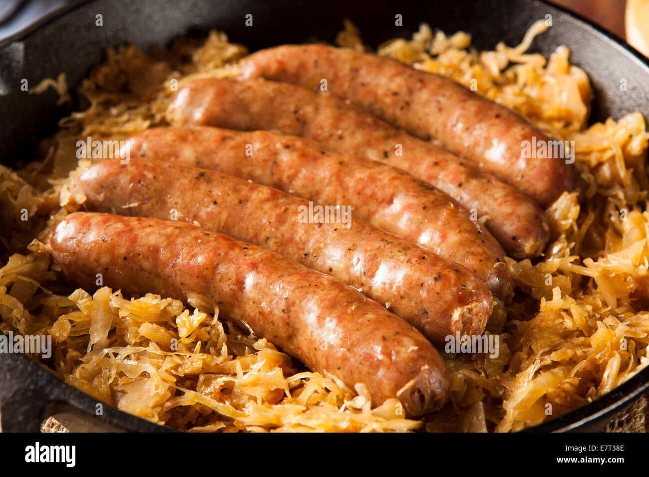 Roasted Beer Bratwurst with Saurkraut in a Pan Stock Photo