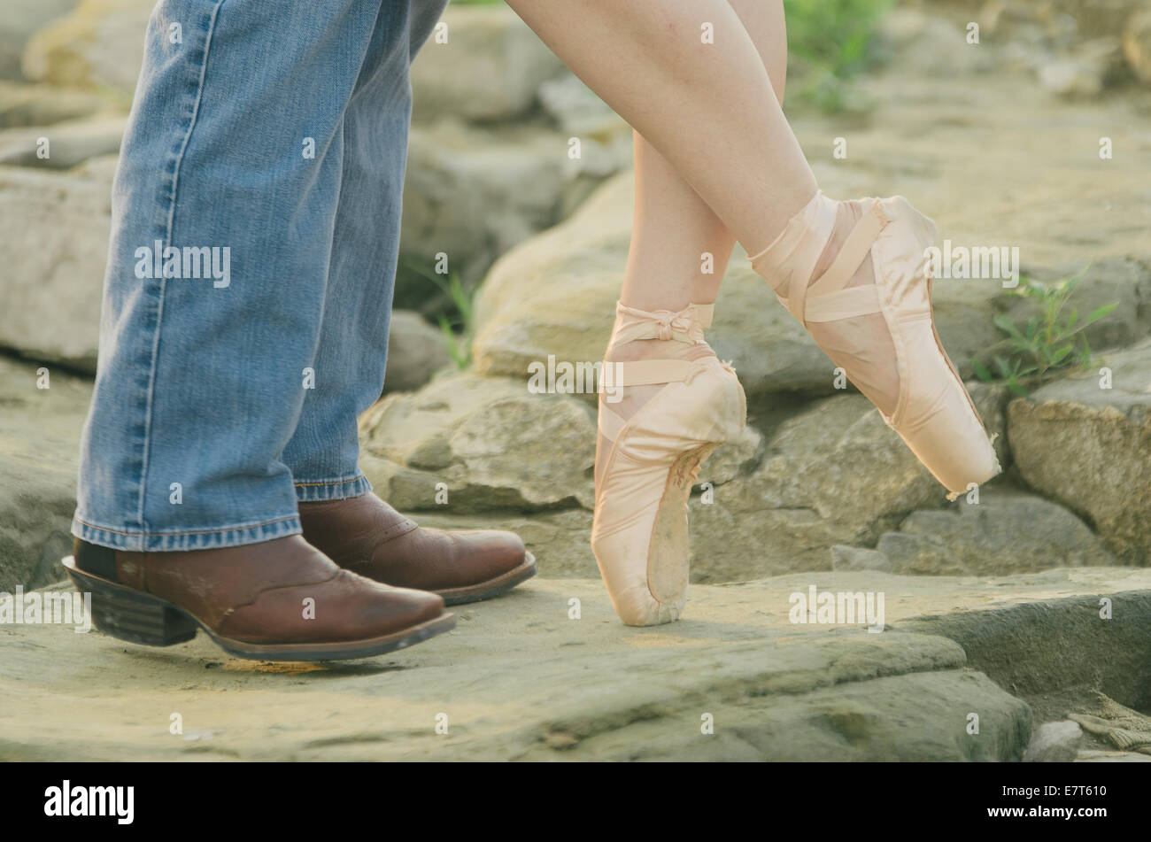 Detail Of A Man On Cowboy Boots And A Woman Wearing Ballet Shoes